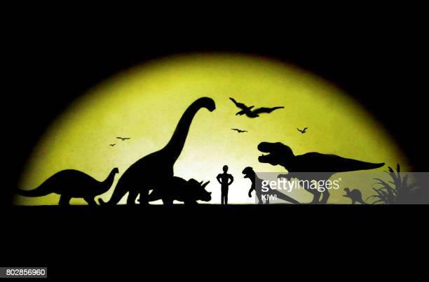 Little boy and his dinosaur companion (light and shadow)