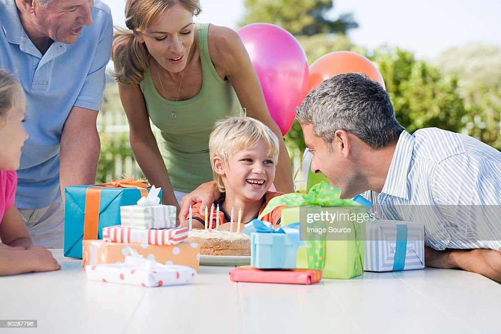 Little boy and his family at his birthday party : Stock Photo