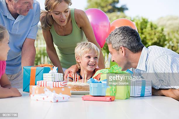 Little boy and his family at his birthday party