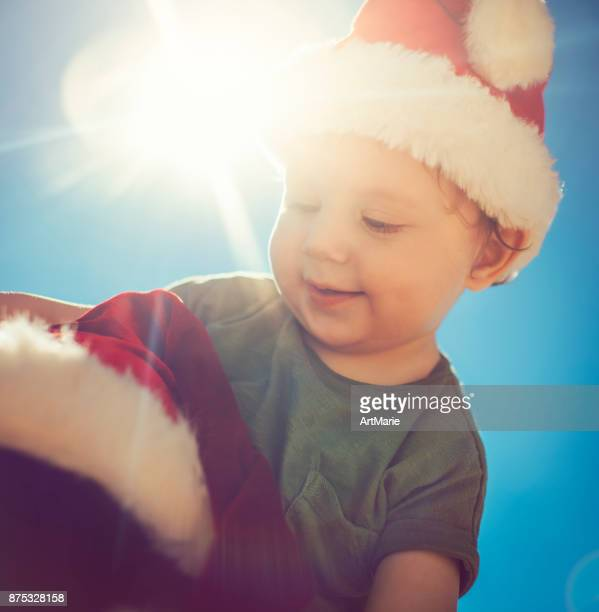 Little boy and his father on Christmas on the beach