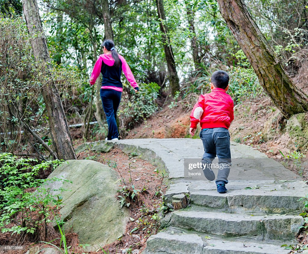 Little boy and his mother climbing stairs : Stock Photo