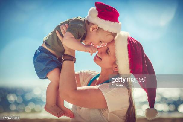 Little boy and his mother on Christmas on the beach