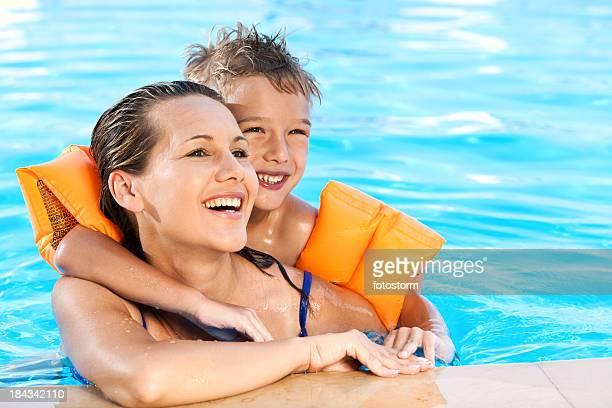 Little Boy And His Mother Relaxing In The Swimming Pool