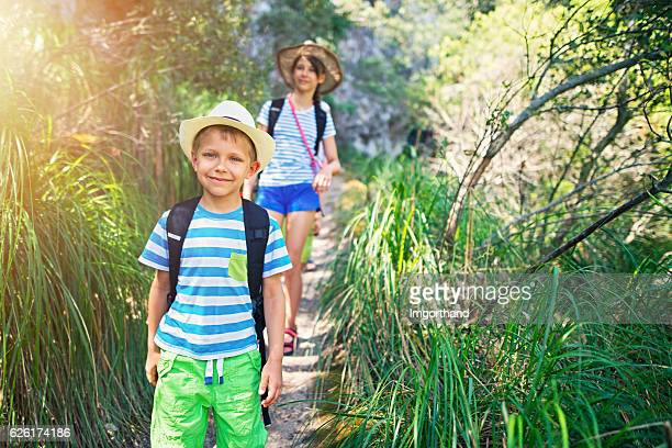 little boy and his sister hiking in majorca mountains - tween girls hot stock photos and pictures