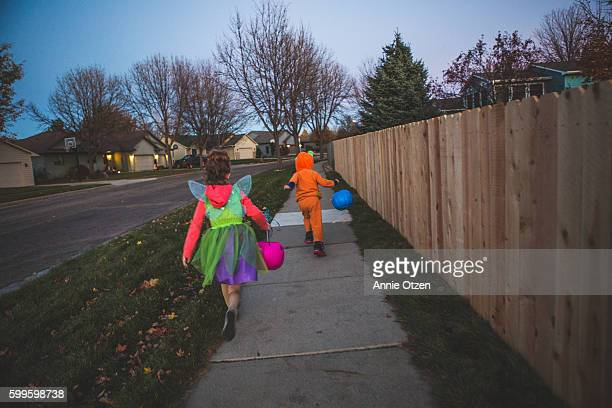 little boy and little girl trick or treating - trick or treat stock pictures, royalty-free photos & images