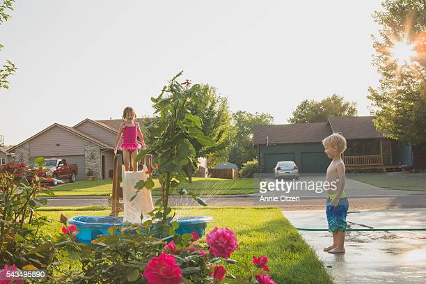 little boy and little girl with kiddie pool - annie sprinkle stock pictures, royalty-free photos & images