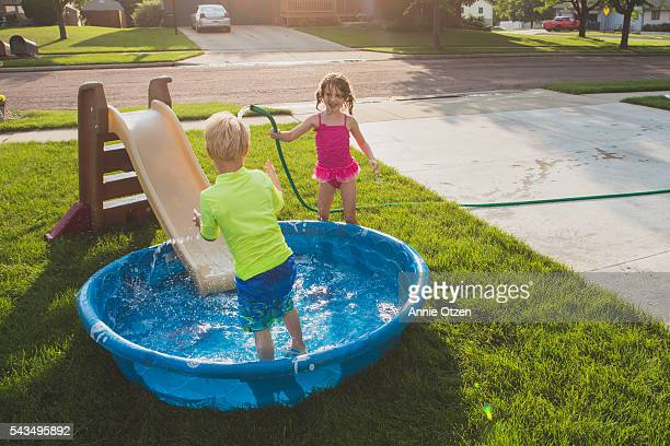 Little boy and Little Girl with Kiddie Pool