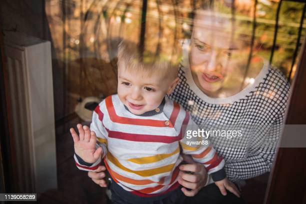 little boy and mother - waving stock pictures, royalty-free photos & images