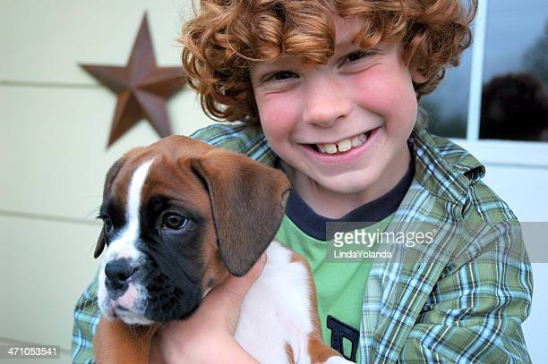 little boy and puppy - boxer dog stock pictures, royalty-free photos & images