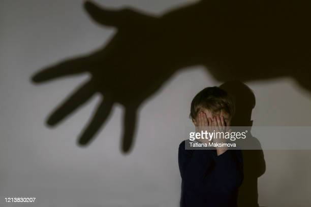 little boy and scary shadow of hand - childhood stock pictures, royalty-free photos & images