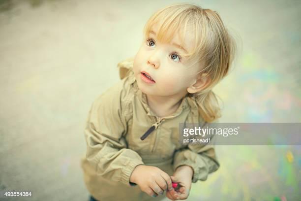 Little boy and sidewalk chalks