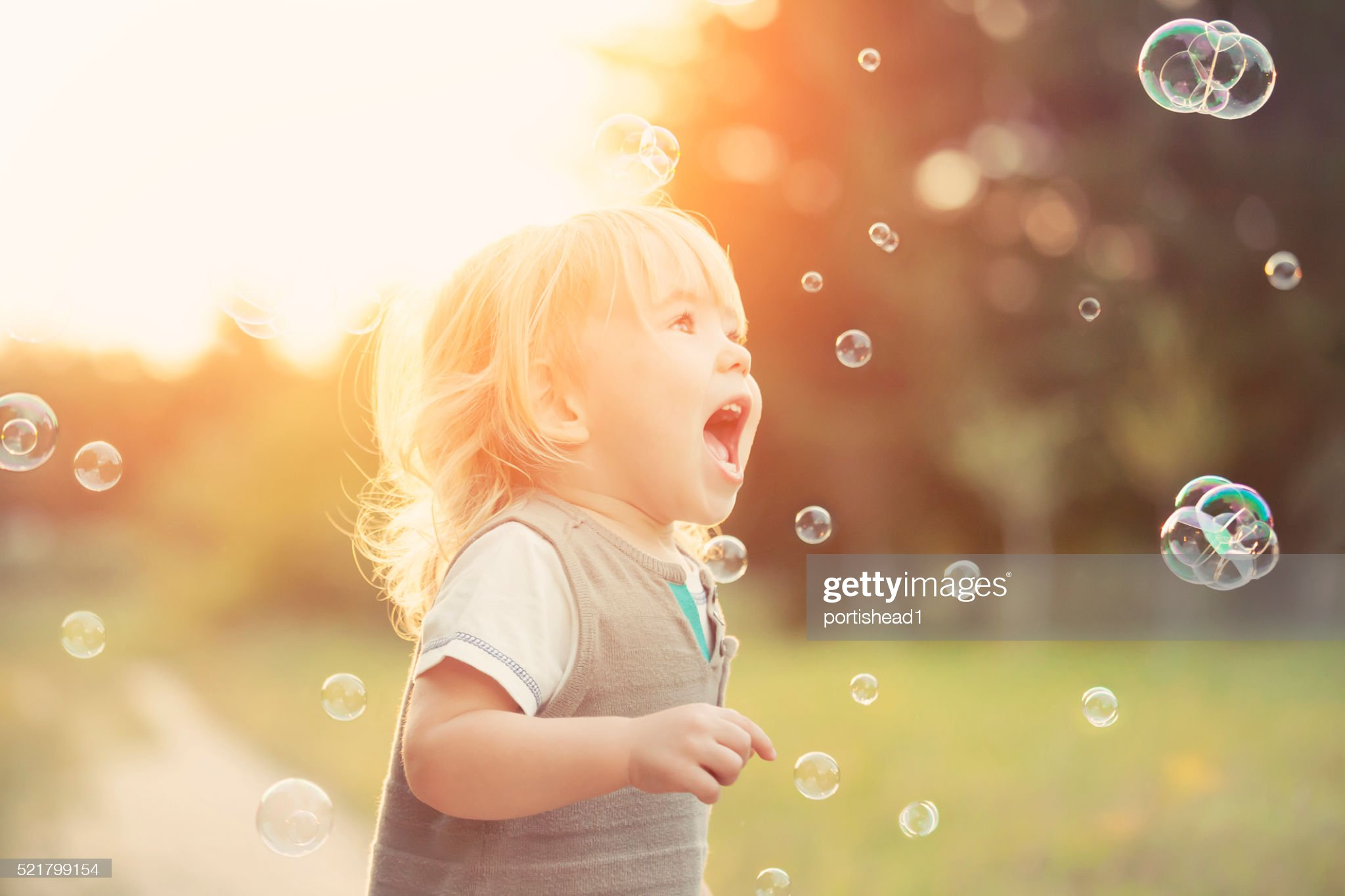 Little boy and soap bubbles : Stock Photo