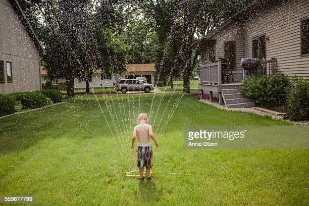 Little boy and sprinkler