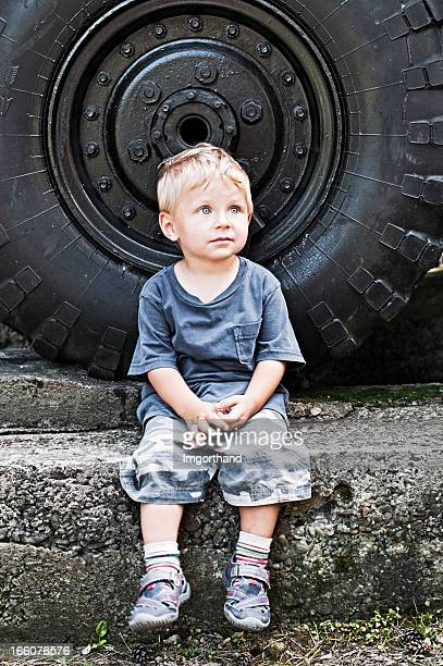 Little boy and the big car