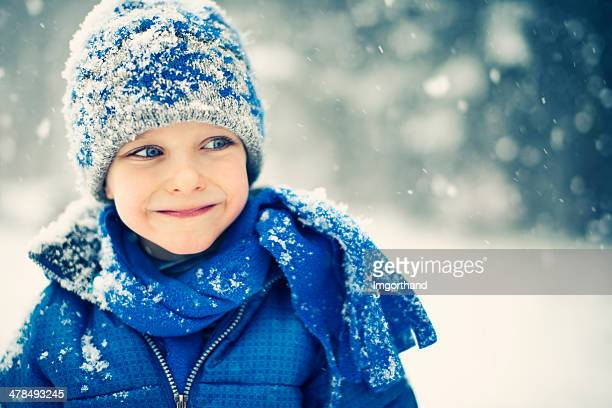 little boy and the snow - blue jacket stock pictures, royalty-free photos & images