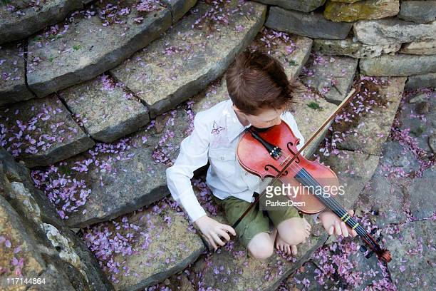 Little Boy and Violin on Stone Steps with Flower Petals