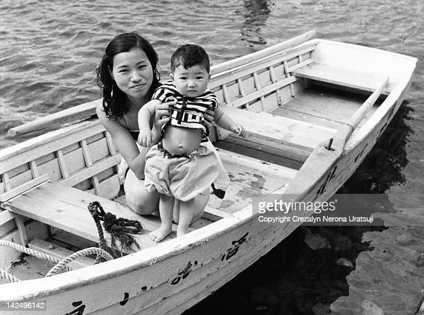 little boy and woman in boat - 昭和期 ストックフォトと画像