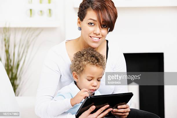 Little Boy And Young Mother/ Sister Using A Digital Tablet