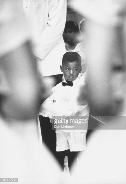 Little boy as ringbearer at African American wedding