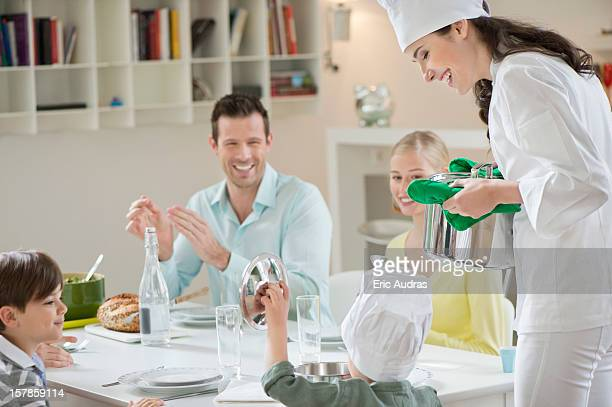 Little boy assisting his mother in serving dinner