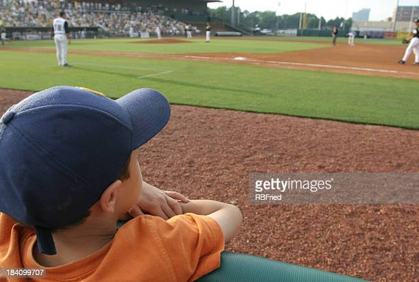 Little boy at baseball game dreams concept