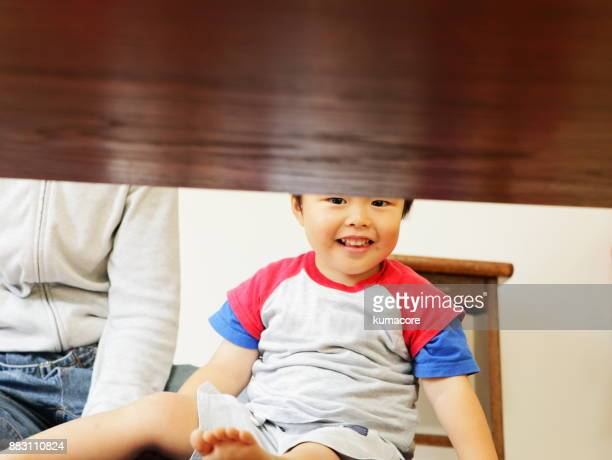 Little boy at looking under the table