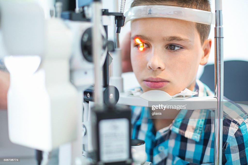 Little boy at optician's office. : Stock Photo