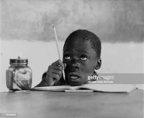 A little boy at school in Luanda capital of Angola shortly after the country's independence circa 1975