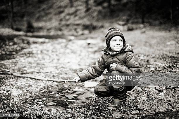 little boy at the stream - imgorthand stock photos and pictures