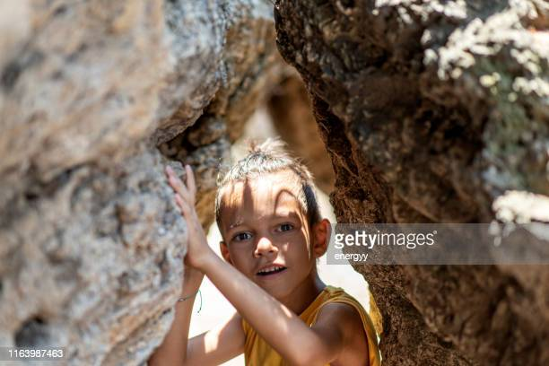 little boy between the rocks - outdoor pursuit stock pictures, royalty-free photos & images