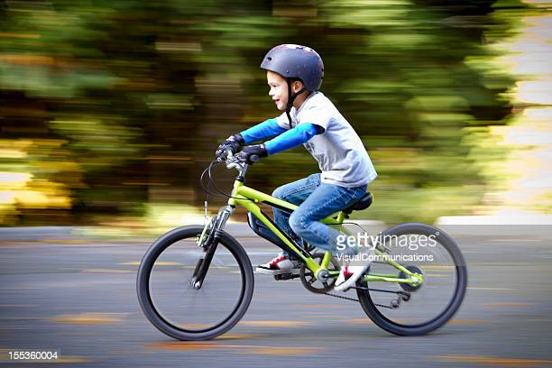 Little boy biking.