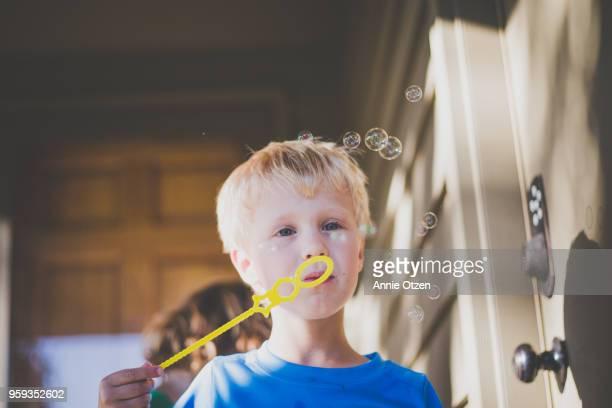 Little boy blowing little bubbles