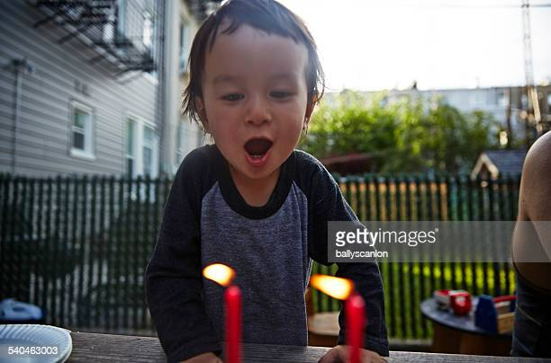Little Boy Blowing Out Birthday Candle.