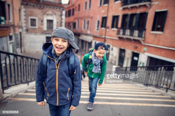 Little boy brothers visiting Venice, Italy