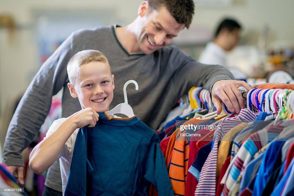 Little Boy Buying a Shirt : Stock Photo