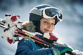 portrait little boy enjoying skiing winter