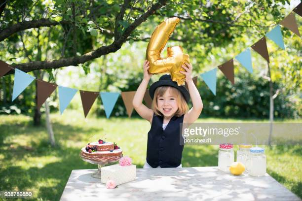 little boy celebrating birthday party - birthday balloons stock photos and pictures