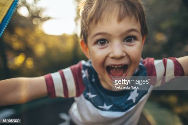 little boy celebrating fourth of july - independence day stock pictures, royalty-free photos & images