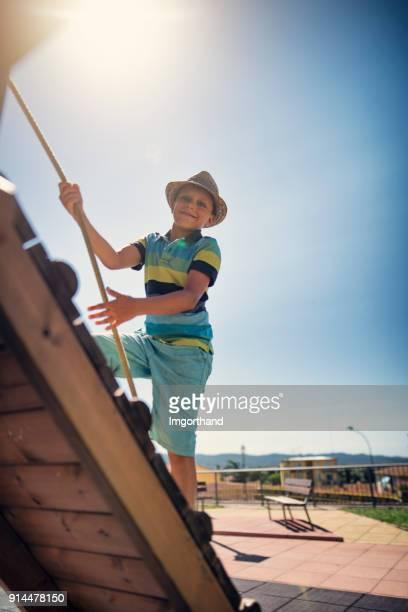 Little boy climbing in playground