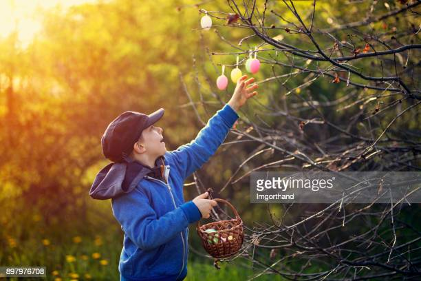 Little boy collecting easter eggs