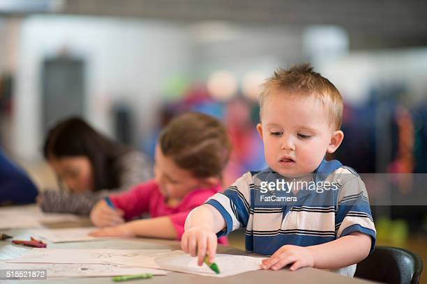 Little Boy Coloring in Class