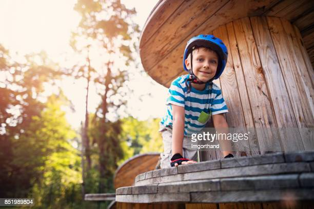 Little boy completing obstacle course