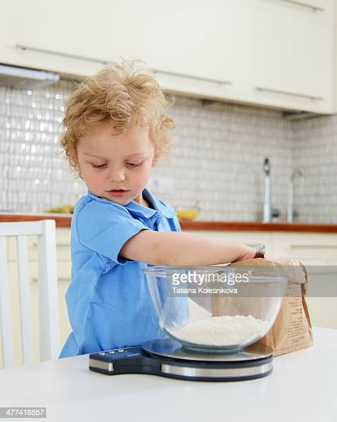 Little boy cooking at home