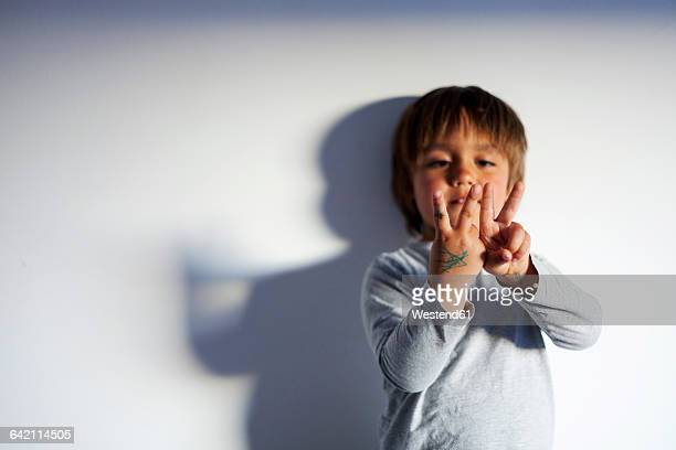 Little boy counting with his fingers