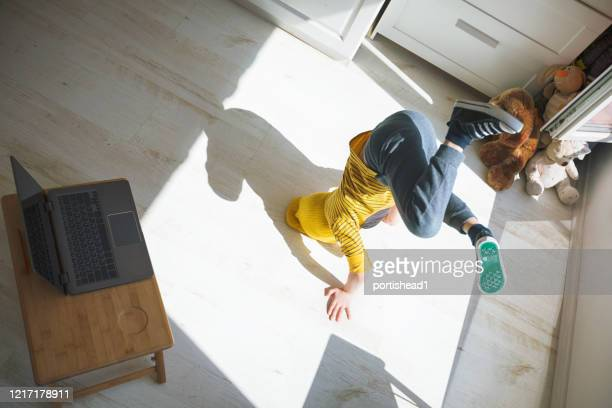 little boy dancing break at home. headstand. home pleasures. e-learning - acrobatic activity stock pictures, royalty-free photos & images