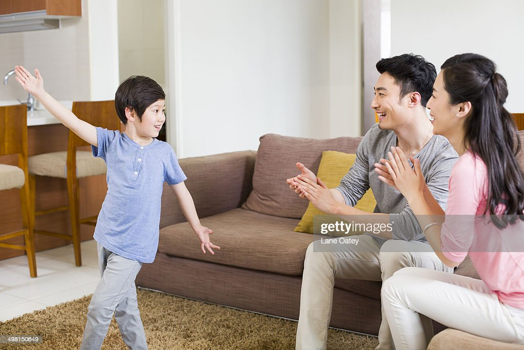 Little boy dancing for parents : Stock Photo