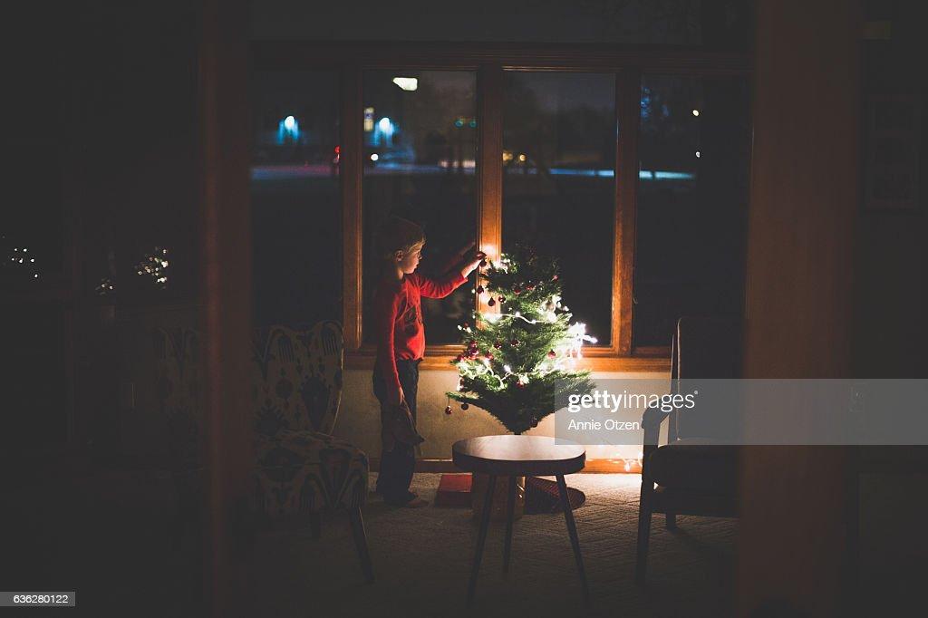Little Boy Decorating Christmas tree : Stock Photo