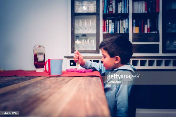 Little boy dining