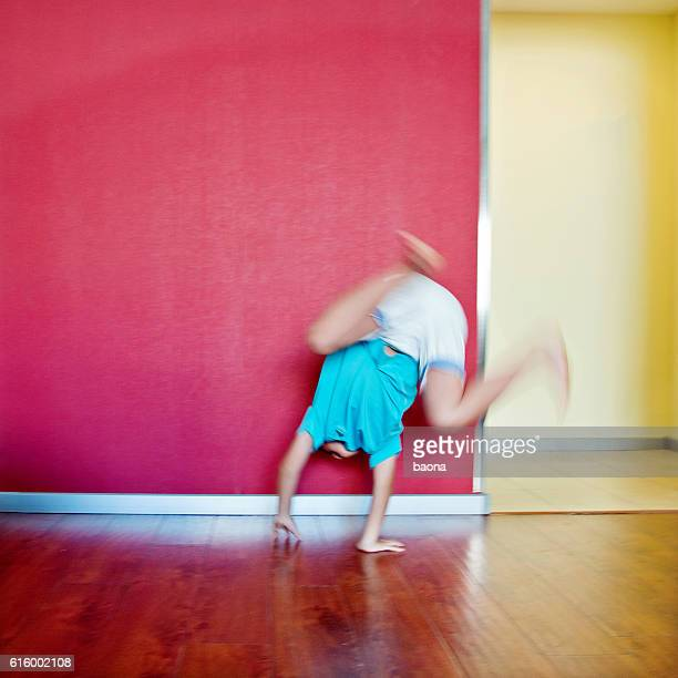 Little boy doing a somersault at home