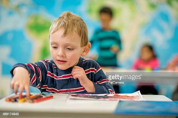 Little Boy Doing an Art Project